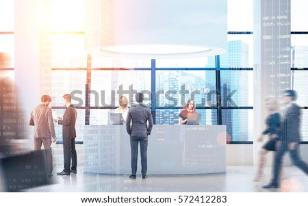 Rear view of people near a round reception desk with columns by its sides. 3d rendering. Toned image. Mock up. Double exposure. #572412283