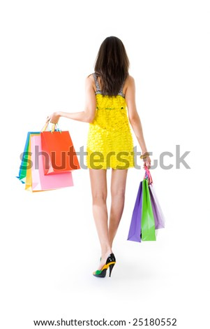 Rear view of pretty woman walking away after shopping on white background
