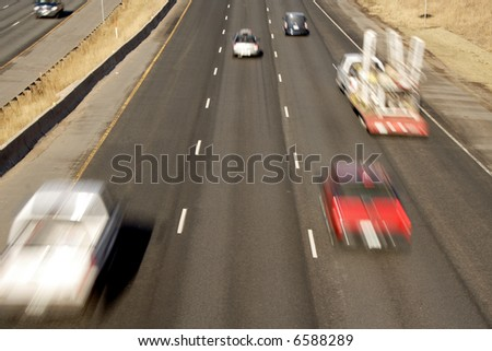 rear view of quick blurred cars