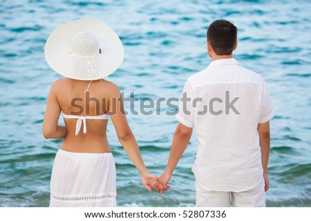Rear view of romantic couple near the ocean