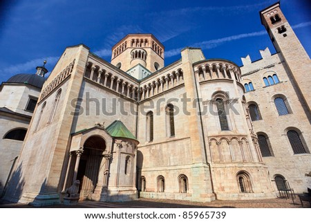 Rear view of San Vigilius cathedral of XII-XIV in main square of Trento built of pink marble of Verona in early gothic style