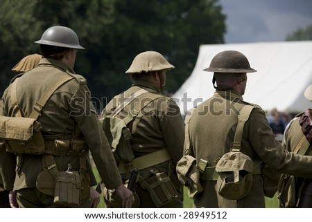 rear view of some ww1 british soldiers marching away
