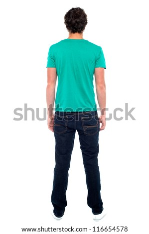 Rear view of teen guy in casuals. Full length portrait #116654578