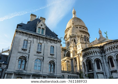 Rear view of the dome of the Basilica of the Sacred Heart of Paris at sunrise with the guesthouse of the Basilica in the foreground. #761188933