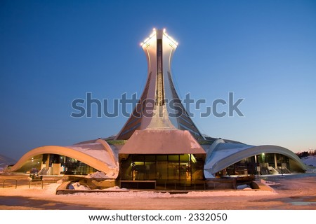 Rear view of the Montreal Olympic Stadium and the world's tallest inclined tower. Taken at dusk in winter.