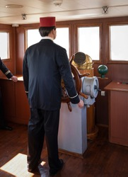 Rear view of the ottoman naval soldier at the ship's helm