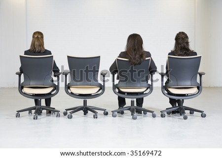 Rear view of three business women