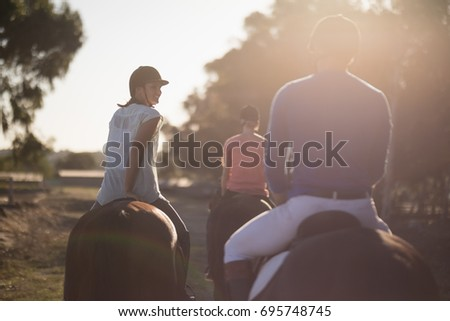 rear view of trainer with women ...
