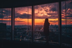 Rear view of Traveler woman looking Tokyo Skyline and view of skyscrapers on the observation deck at sunset in Japan. Vintage tone