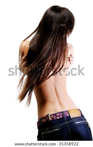 rear view of young attractive woman with long brown hair in motion