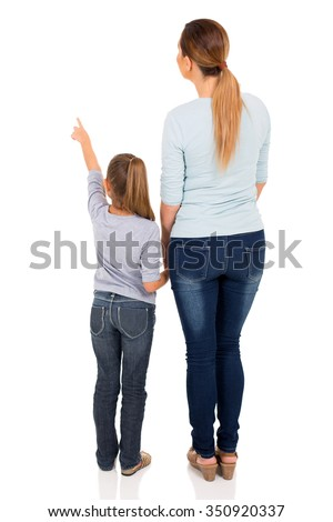rear view of young mother and daughter pointing at empty space #350920337