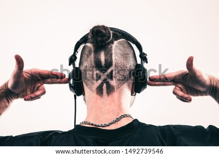 rear view - the rapper headphones with a stylish hairdo and a tattoo