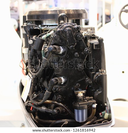 Rear view to opened new 3 cylinder two stroke outboard motor - motor boat service & repair #1261816942