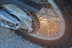 Rear wheel drive bike. The chain mechanism close-up. The links of the chain and sprocket of motorcycle gear.
