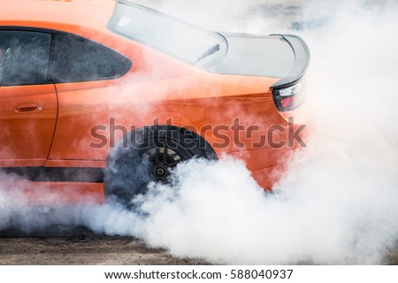Rear wheel drive super sport car burning tire for warm up before competition to increase type temperature for good traction and grip. #588040937