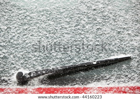 rear windscreen wiper on a car covered with snow