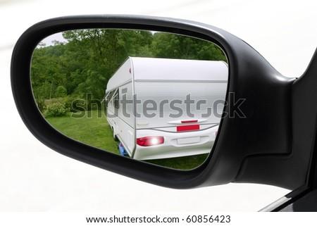 rearview car driving mirror meadow camping caravan [Photo Illustration]