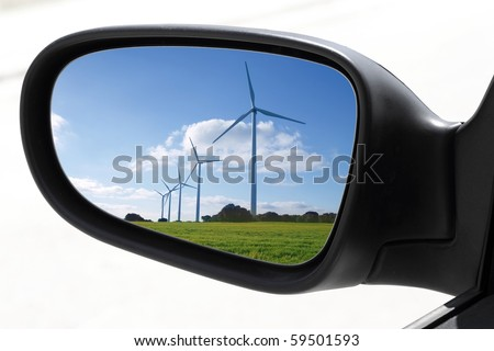 rearview car driving mirror view windmill electric aerogenerator  [Photo Illustration]