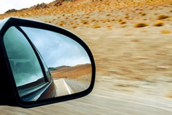 Rearview mirror of a car with mountain landscape in Catamarca, Argentina