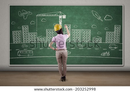 Rearview of female engineer making the project design
