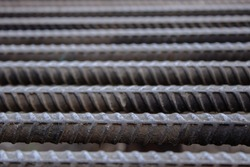 Rebar, known when massed as reinforcing steel or reinforcement steel. Steel reinforcement bars or rods used to reinforce concrete. Close up macro