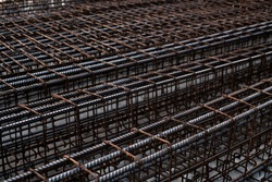 rebar steel bars, reinforcement concrete bars with wire rod used in foundation of construction site.