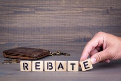 Rebate. Wooden letters on dark background