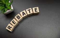 Rebate word on wooden cubes, business concept.