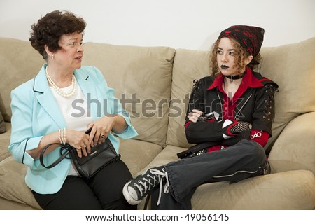 Rebellious teen and worried mother have trouble communicating with each other. - stock photo