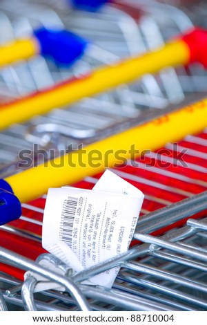 Receipts on a shopping cart