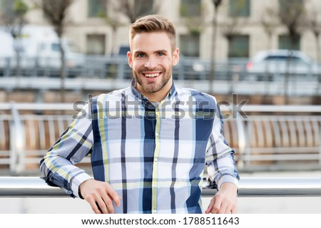 Receiving care at barbershop. Unshaven guy smile in casual style outdoors. Barbershop. Barber shop. Haircut and shave salon. Barbershop service. Barbershop and grooming.