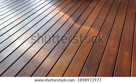 Recently oiled Australian Spotted Gum decking, Merbau oil stained spotted Gum, sunlight and shadows on Spotted Gum Decking