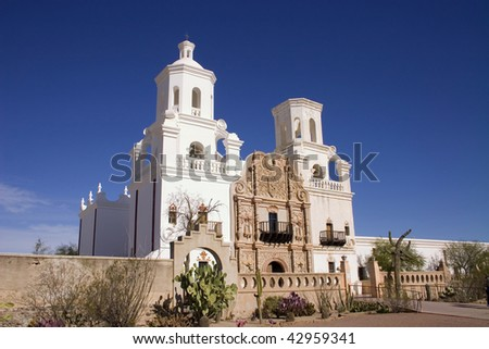 Recently restored Mission San Xavier del Bac south of Tucson Arizona showing two bell towers with cross on the Tohono O'odham San Xavier Indian Reservation