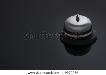 Reception Concierge Bell on a dark background with space for text. Hotel and resort Illustration.