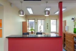 Reception desk in small medical clinic, horizontal