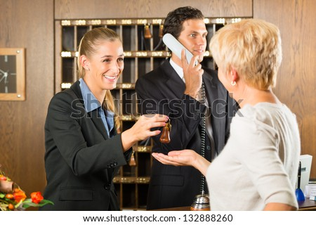 Reception - Guest checking in a hotel at the front desk, the service is friendly