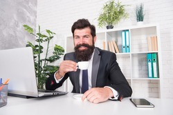 Reception room. Respectable ceo. Man handsome boss sit in office drinking coffee. Comfy workspace. Bearded hipster formal suit relaxing with coffee. Office life is unthinkable without good coffee.