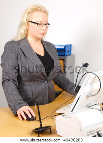 receptionist in front of desk and monitor