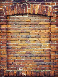 Recess arch frame in old brick wall