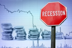 Recession sign on economy background - graph and coins. Financial crash in world economy because of coronavirus. Global economic crisis, recession. Corona virus pandemic, COVID-19 outbreak.