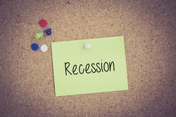 Recession written on sticky note pinned on pinboard