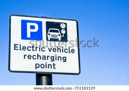 Recharging Point for Electric Vehicles Sign against Clear Sky #751183129
