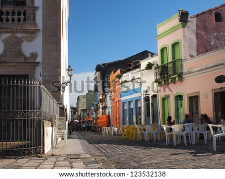 RECIFE, BRAZIL, SOUTH AMERICA - JULY 17, 2012: Horizontal photo of the colonial architecture on one of the streets in the historical center of Recife. People on the street, blue sky in the background.