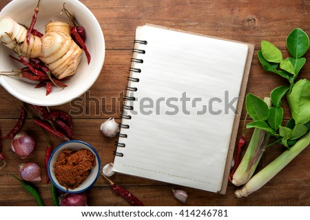 recipe book with fresh herbs south asia and spices on wooden background, thai food.