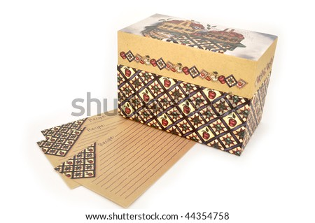 Recipe box and three recipe cards isolated on a white background