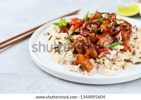 recipe teriyaki chicken's  with chili pepper and sesame seeds, with rice. on a white plate, copy space, selective focus, Asian cuisine, Chinese cuisine, Thai cuisine. food flat lay. light background