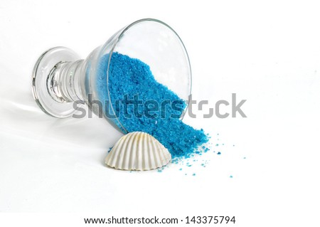 recipient with salts of bathroom of blue color and shell
