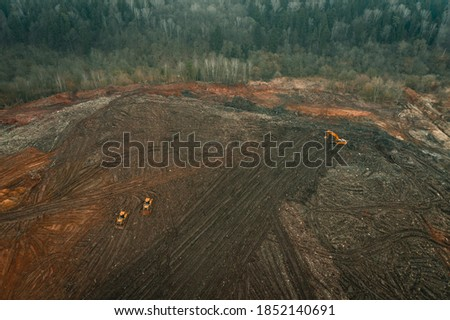 Reclamation of solid waste landfill by heavy machinery Stockfoto ©