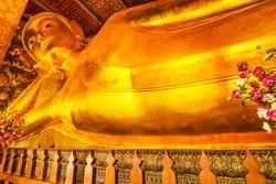 Reclining Buddha gold statue. Wat Pho, Bangkok, Thailand