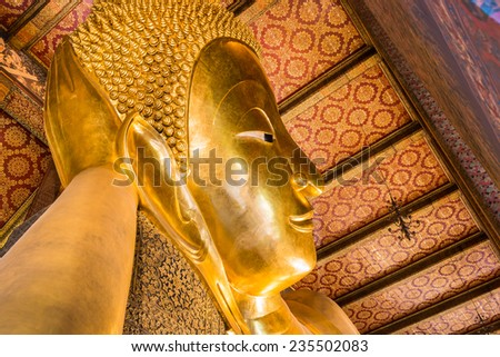 Reclining Buddha gold statue ,Wat Pho, Bangkok, Thailand,They are public domain or treasure of Buddhism, no restrict in copy or use